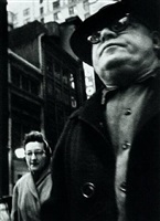 man forground, woman behind by william klein