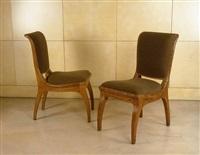 paire de chaises en chêne sculpté by armand-albert rateau