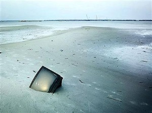 in katrina's wake: tv in sand, bay st.louis by stephen wilkes