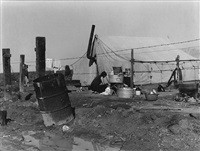 migrant camp washing by dorothea lange