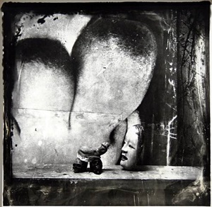 mask and severed genitalia as netsuke, new mexico by joel-peter witkin