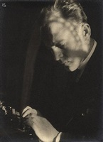 jerome melquist at typewriter by ilse bing