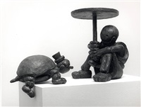girl with turtle; a group by tom otterness
