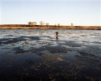 jake wading in a slough, sheridan county, nd by brian lesteberg
