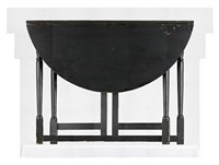 a set of photographs of a black gateleg table, both open and closed by roy mcmakin