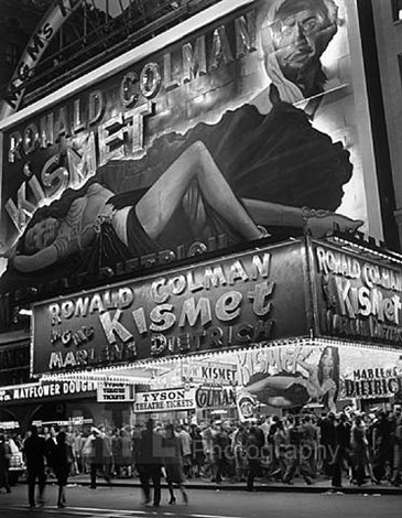 huge billboard depicting marlene dietrich reclining over the astor movie theatre marquee, advertising the movie kismet, broadway and times square, new york by andreas feininger