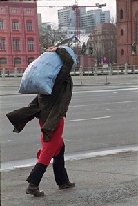 man with heavy sack by stephen waddell