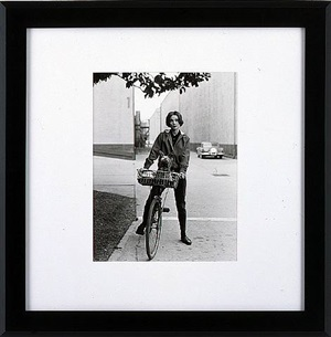 audrey hepburn on her bike with pet dog, famous, at paramount by sid avery