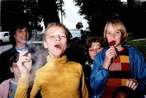 boy in yellow shirt smoking by mark cohen