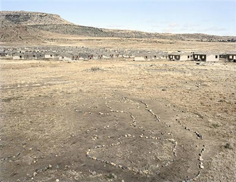 remains of households in a children's game called onopopi, and the shells of incomplete houses in a housing scheme that stalled.kwezinaledi, lady grey, eastern cape, 5 august 2006 by david goldblatt
