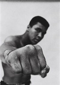 Muhammed Ali showing off his right..., 1966