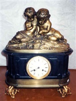 a charles x gilt-metal and marble figural clock (384)