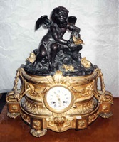 a louis xv style patinated and gilt-bronze mantel clock (385)