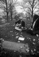 bob dylan and allen ginsberg at jack kerouac's grave, lowell, ma, 1975 by ken regan