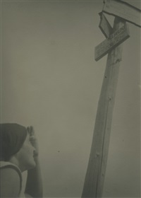 woman looking up at signs by josef bartuska