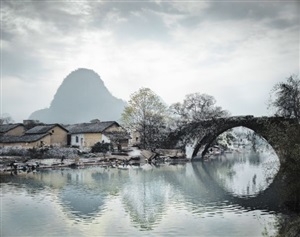 snowy bridge and mountain, guilin, china by stephen wilkes