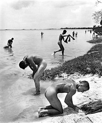 marines on beach, saipan by peter stackpole