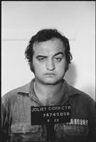 john belushi poses for mugshot, the blues brothers, chicago, illinois by mary ellen mark