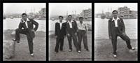 men posing in harbour by akram zaatari