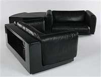 pair of modular sofas and table by cini boeri
