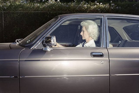 woman caught in traffic while heading southwest on u.s. route 101 near the topanga canyon boulevard exit, woodland hills, california, at 5 38 p.m. in the summer of 1989 by andrew bush
