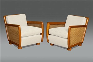 paire de fauteuils cannés by jean royère