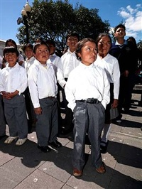 students in the plaza grande for changing of the presidential guard, quito, ecuador by neil meyerhoff