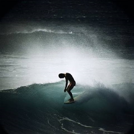 midget farrelly surfing shore break, makaha by leroy grannis