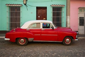 car and superman, trinidad, cuba by jeffrey milstein