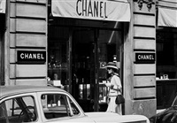 coco chanel in the street, walking from the ritz to the house of chanel, rue cambon by douglas kirkland