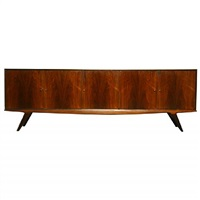 a five door rosewood cabinet with bronzed pulls by john graz by john louis graz