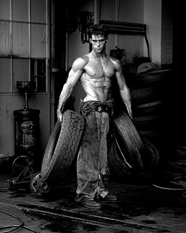 fred with tires, hollywood by herb ritts