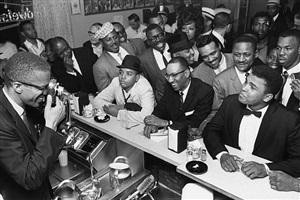 black muslim leader malcolm x photographing cassius clay, miami, 1964 by bob gomel