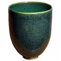a beautiful blue green glaze cup by laura andreson