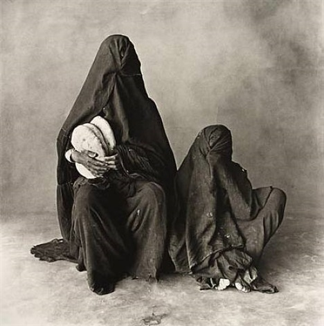 two women in black with bread, morocco by irving penn
