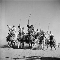 "hassau chieftains demonstrate their superb horsemanship in a ""fantasia"", n'djamena, chari-baguirmi, chad by george rodger"