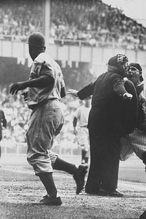 "ny yankee catcher yogi berra protesting""safe"" call on brooklyn dodger jackie robinson who just stole home base at the 1st game of the world series, september 28, 1955 by grey villet"