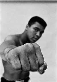 muhammad ali shows off his right fist, chicago by thomas hoepker