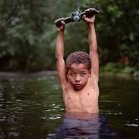 emerging boy by mona kuhn