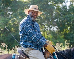 <!--13-->black cowboys: horseback portraits: older man with yellow riding gloves, circle 44 trail ride, houston, texas by andrea robbins and max becher