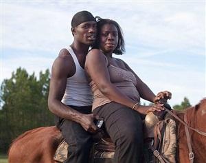 <!--13-->black cowboys: horseback portraits: couple, swainsboro, georgia by andrea robbins and max becher