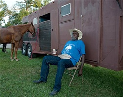 <!--14-->black cowboys: hanging out: relaxing man, juneteenth trail ride, lil henry's place, beaumont, texas by andrea robbins and max becher