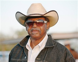 <!--15-->black cowboys: portraits: man with sunglasses, laday's arena, lovelady, texas by andrea robbins and max becher