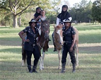 <!--18-->black cowboys: group portraits: four cowgirls in black, janetta blanding, jeanette bellinger (twins), on horseback, sharia na'en and her mother, ciandra na'en, swainsboro, georgia by andrea robbins and max becher