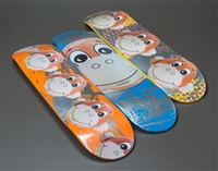 a suite of three monkey train skate decks by jeff koons
