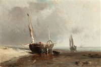 fishing boats on the shore at low tide by louis bentabole