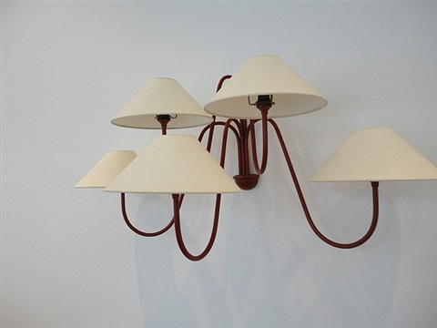 pair of red painted iron five arm wall lights by jean royère