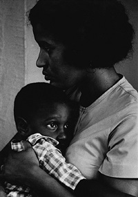 mrs. medgar evers (myrlie) holds her son, van, the day after her husband, was assassinated with a rifle. taken in the evers' home, jackson, mississippi june 13,1963 by flip schulke