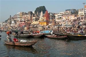 man sitting in boat at ghat by neil meyerhoff