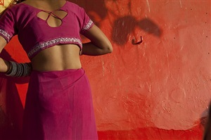 woman changing into dry sari by neil meyerhoff